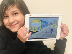 Mia from Oakleigh South Primary School shows off her winning poster.