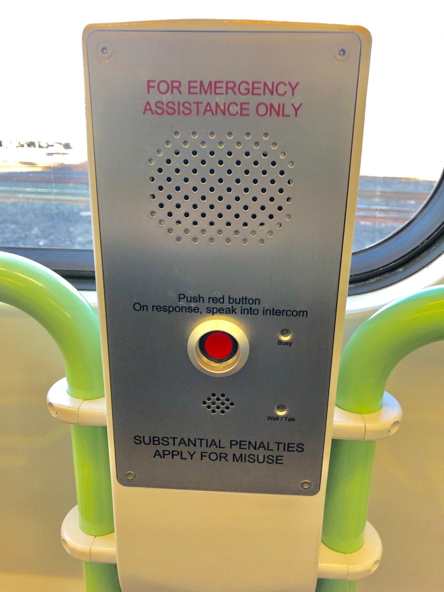 photo of emergency assist intercom located in the train carriage
